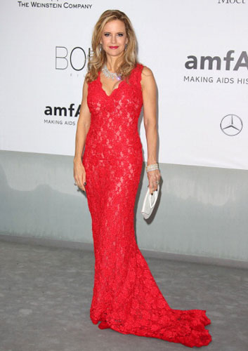 KELLY PRESTON <br/>Red cord lace gown with silk <br/>ribbons hand embroidered throughout <br/>21st amfAR CINEMA AGAINST AIDS gala <br/>Cannes Film Festival <br/>Cap d'Antibes, France <br/>May 22, 2014
