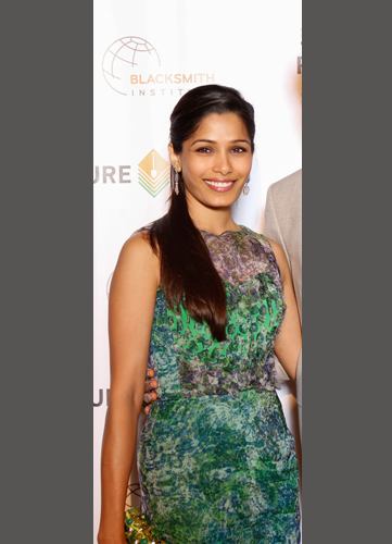 FREIDA PINTO <br/>Green printed silk organza dress <br/>Pure Earth Benefit <br/>New York, NY <br/>April 26, 2014