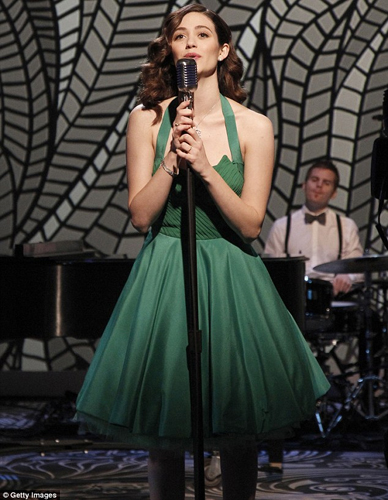 EMMY ROSSUM in a 1950's-inspired <br/>green silk chiffon & crepe de chine<br/> cocktail dress accented with <br/>peeping silk tulle petticoat.  <br/>THE VIEW <br/>New York, NY <br/>January 15, 2013
